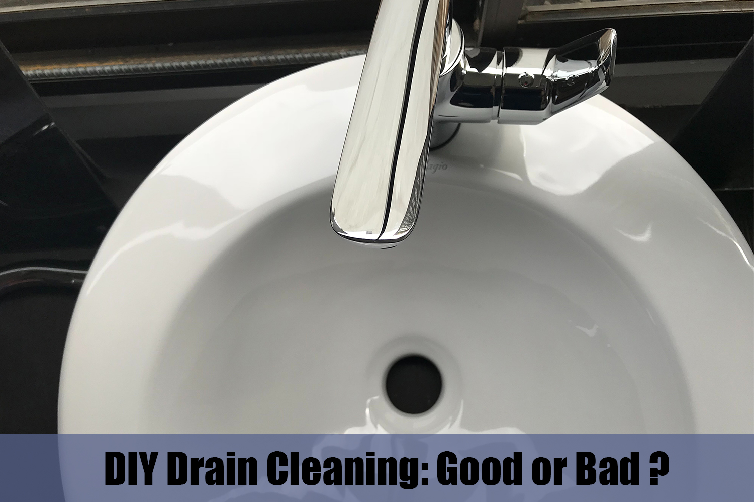 Looking down on white sink with clogged drain. DIY drain cleaning might not be the best option though.