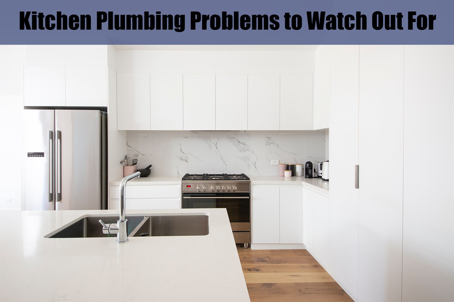 A clean white kitchen; to keep clean, it's important to watch out for kitchen plumbing problems.